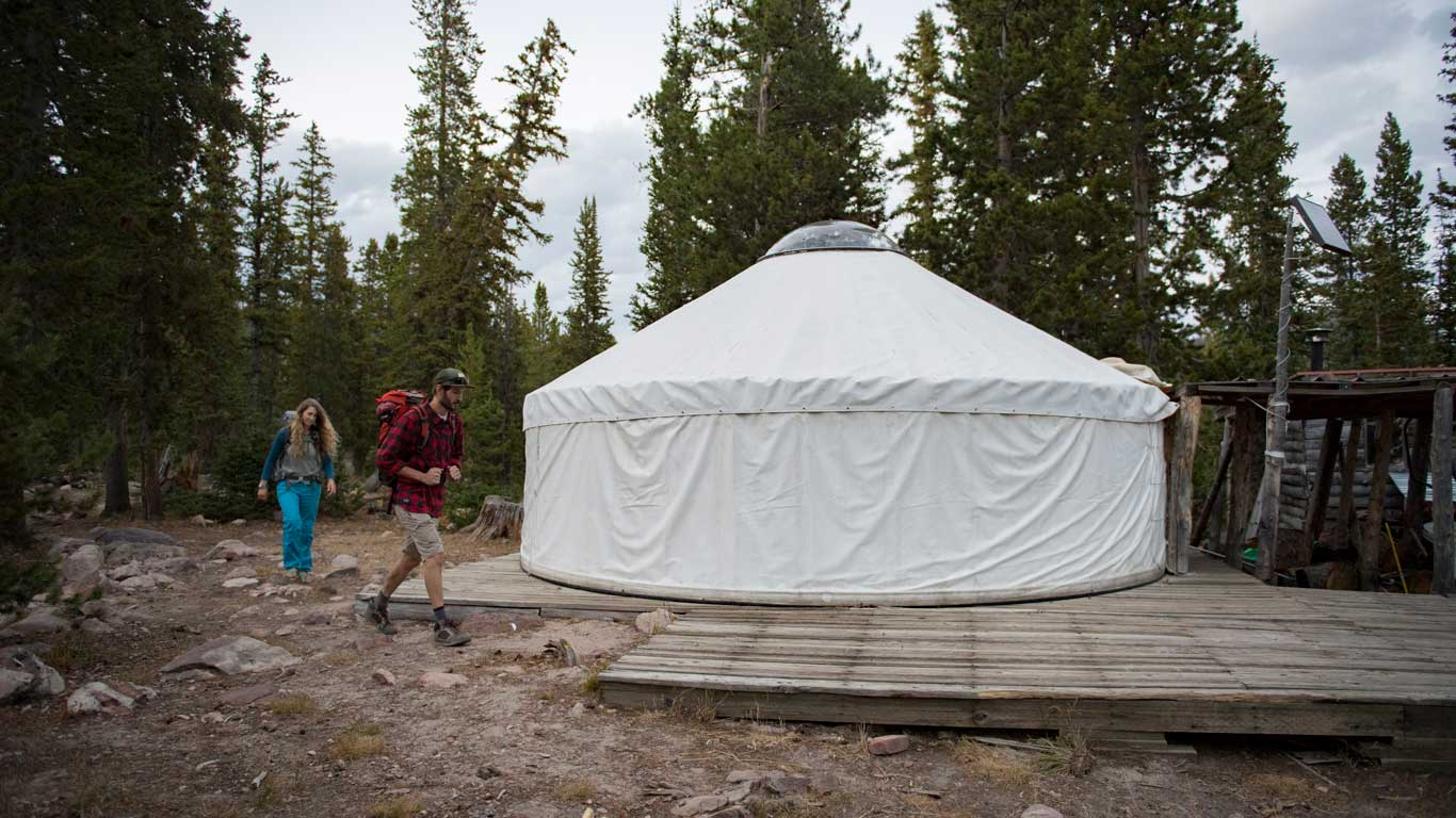 Two backpackers arrive at the Castle Peak Yurt in the Uinta Mountains
