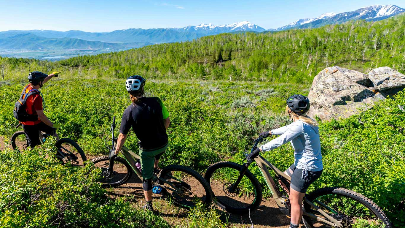 Three mountain bikers riding the WOW trail in Park City, UT