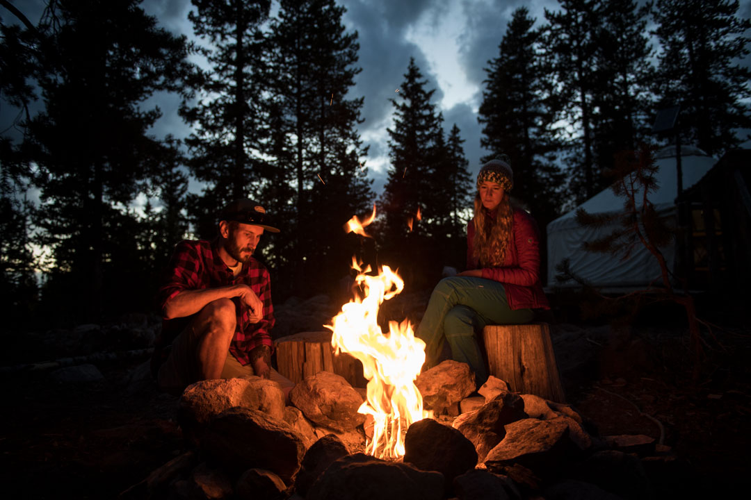 Wnjoying the camp fire at night at the White Pine Touring Uinta Mountains Yurt