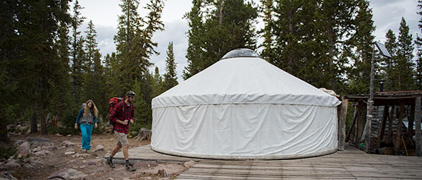 Snowshoeing in winter to the White Pine Touring Yurt for camping in the Uinta mountains in UT
