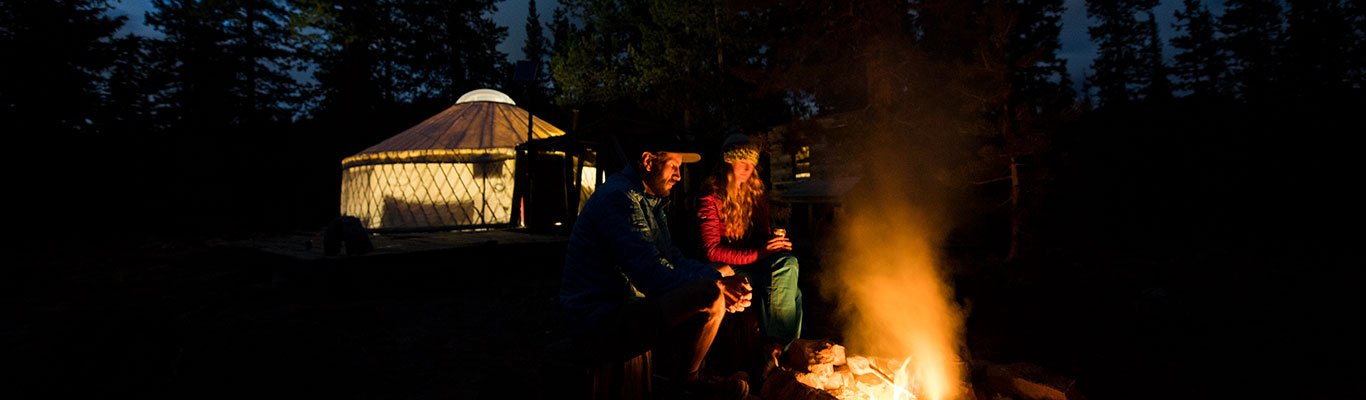 Evening by the fire with White Pine Touring Yurt camping in the Uinta mountains in UT